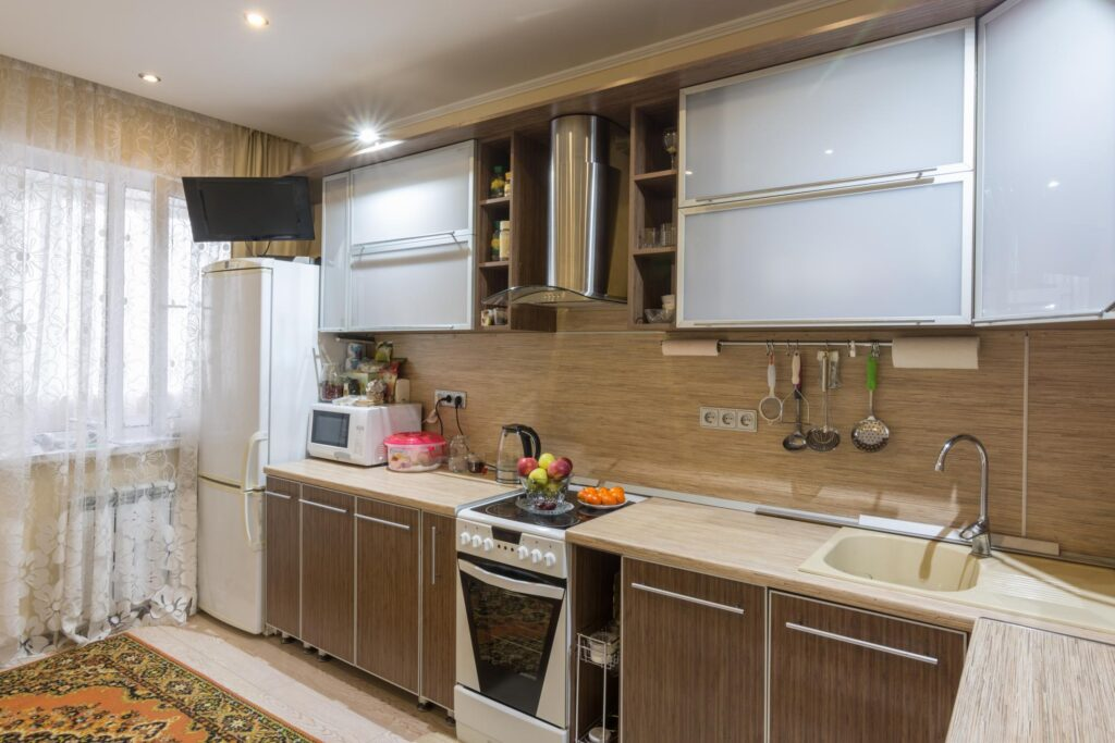 a kitchen with built in cabinets