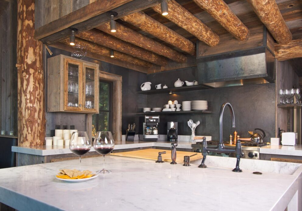 a kitchen with log ceiling